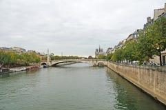 Seine embankment in autumn weather. Royalty Free Stock Photo