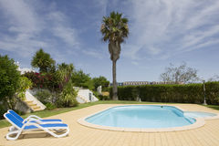Beautiful villa with a healthy garden and pool Stock Image