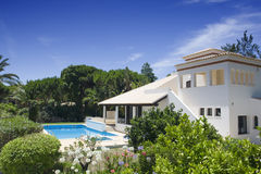 Beautiful villa with a healthy garden and pool Royalty Free Stock Photography