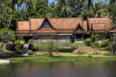 Beautiful villa with palm trees near water Royalty Free Stock Photography