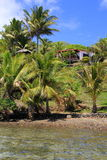 Beautiful villa on shores of tropical beach Royalty Free Stock Images