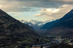 Beautiful village located in a valley surrounded by mountains at sunset stock photo