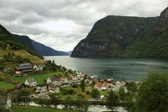 Beautiful village of Undredal. In Norway`s `fjord country` along the Aurlandsfjord between Flam and Gudvangen there is a small village of Undredal. Captured in Stock Photo