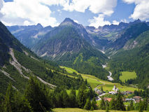 Beautiful village in a valley in the alps Stock Photos