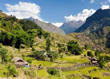 Beautiful village in western Nepal with mount Dhaulagiri Royalty Free Stock Photo
