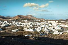Free Beautiful Village Yaiza With View To The Volcanoes Of Lanzarote Stock Photos - 65866973