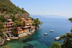 Beautiful villas on the shore of Portofino with clear green water of the Mediterranean sea, Portofino, Italy. Stock Photo