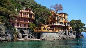 Beautiful villas on the shore of Portofino with clear green water of the Mediterranean sea, Portofino, Italy Stock Photos