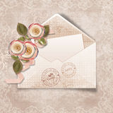 Beautiful  vintage  background with envelope and r Stock Photos