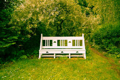 Beautiful vintage bench in the garden Royalty Free Stock Photo