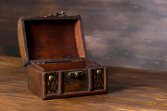 Beautiful vintage chest with open lid on wooden background, clos Stock Photo