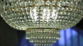 Beautiful vintage crystal chandelier in a room stock video