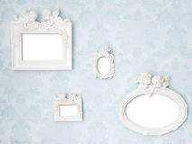 Beautiful vintage frames with Cupids on tender blue damask background. Wall with photo gallery royalty free stock photos
