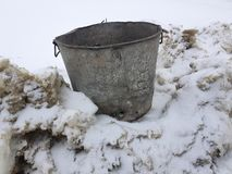 Beautiful vintage garbage can on snow royalty free stock photo