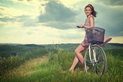 Beautiful vintage girl sitting next to bike, summer time stock photos