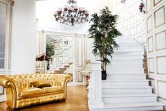 Beautiful vintage gold sofa next to wall (retro-style illustrati Royalty Free Stock Image