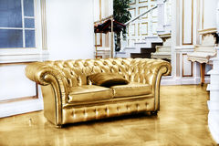 Beautiful vintage gold sofa next to wall (retro-style illustrati Stock Images