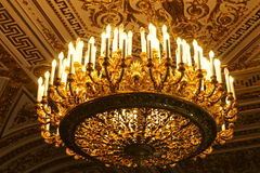 Luxurious vintage chandelier bottom view. Beautiful vintage golden illuminated chandelier bottom view Stock Images