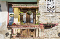 Beautiful vintage greek  balcony with hanging pot flowers Royalty Free Stock Photos