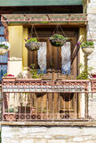 Beautiful vintage greek  balcony with hanging pot flowers Royalty Free Stock Image