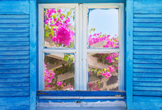Beautiful vintage Greek window with blue shutters. Typical Greek picture. Stock Photos
