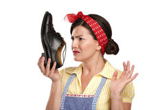Beautiful vintage housekeeper holding  a smelly shoes with facia Royalty Free Stock Image