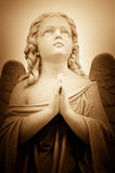 Beautiful vintage image of a praying angel Stock Photos