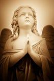 Beautiful vintage image of a praying angel Stock Photos