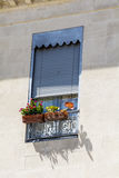 Beautiful vintage italian balcony with pot flowers Stock Photography