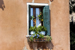 Beautiful vintage italian balcony with pot flowers Royalty Free Stock Images