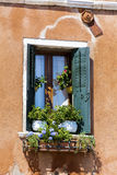 Beautiful vintage italian balcony with pot flowers Royalty Free Stock Image