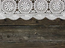 Beautiful vintage knitted lace on wooden Royalty Free Stock Photography
