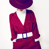 Beautiful vintage lady fashionable style in a red cloak and hat. Beautiful vintage lady fashionable style Stock Photos