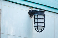 Beautiful vintage lamp on the wall. Royalty Free Stock Photo