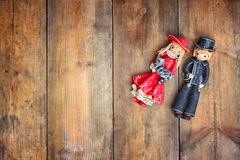 A beautiful vintage old pair dolls over a wooden background Royalty Free Stock Images