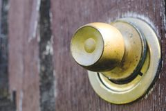 Beautiful vintage and old, rustic door look, cracked brown paint. Wooden door and rusty iron lock and keyhole. Closeup of old rusty door lock on wooden Stock Photography
