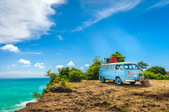 Beautiful Vintage retro car Volkswagen van hippie minibus with travel suitcase Royalty Free Stock Photo