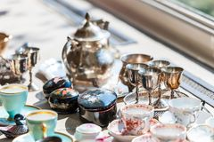 Beautiful vintage set of cups and saucers in porcelain and silver royalty free stock image