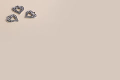 Beautiful vintage silver metal love hearts for Weddings or valentines. On a cream background Stock Image