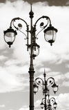 Beautiful vintage street lights, blue sky clouds Stock Photo