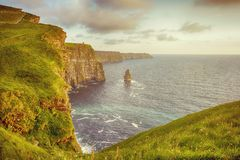 Beautiful vintage style scenic irish countryside landscape from the cliffs of moher in ireland. Beautiful vintage style scenic irish countryside landscape from Stock Photography