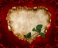 Beautiful Vintage Stylized Valentine Card. Heart-shaped vintage piece of parchment with a red rose on it. Valentines Day Card romantic love letter on red Royalty Free Stock Image