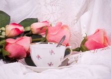Beautiful vintage tea cup with pink roses Royalty Free Stock Photo