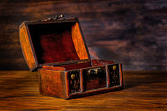 Beautiful vintage treasure of mystery chest on wooden background Stock Photos