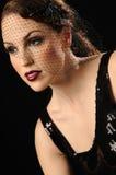 Beautiful vintage woman. Beautiful woman in fashionable vintage head piece Stock Image