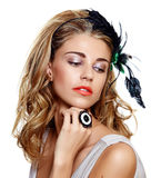 Beautiful vintage woman. Young woman portrait wearing beautiful vintage feather headband on long curly hair Stock Photos