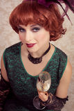 Beautiful vintage woman. With a glass of champagne Royalty Free Stock Photos