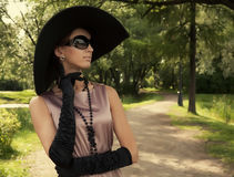 Beautiful vintage woman in summer park. Portrait of a beautiful vintage woman in summer park Stock Photo