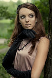 Beautiful vintage woman in summer park. Portrait of a beautiful vintage woman in summer park Stock Photography