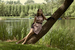 Beautiful vintage woman in summer park. Portrait of a beautiful vintage woman in summer park Stock Images